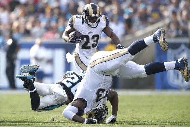 Panthers vs. Rams:  13-10, Panthers  -   Benny Cunningham, Kurt Coleman, Greg Robinson  -  Rams running back Benny Cunningham eludes Panthers safety Kurt Coleman as tackle Greg Robinson tumbles nearby during second-quarter action.