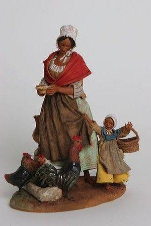 Liliane GUIOMAR - Femme au poulailler avec son enfant