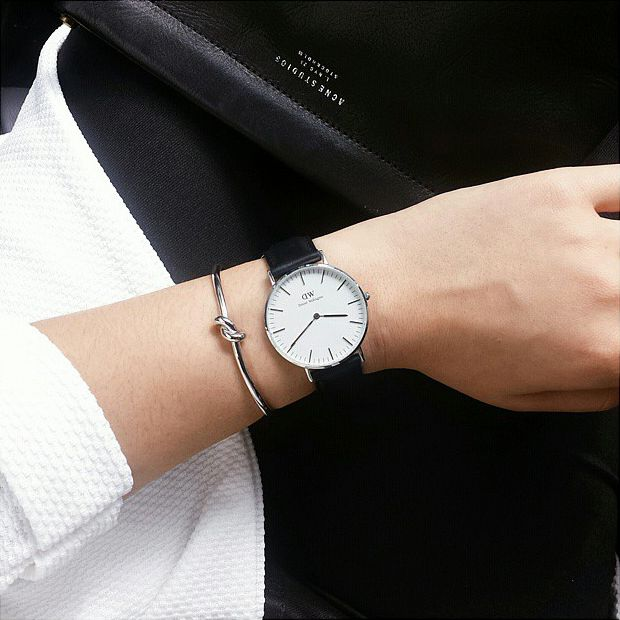 Get the look with our love knot bracelet and our black classic watch. All available at www.StyleRepertoire.com