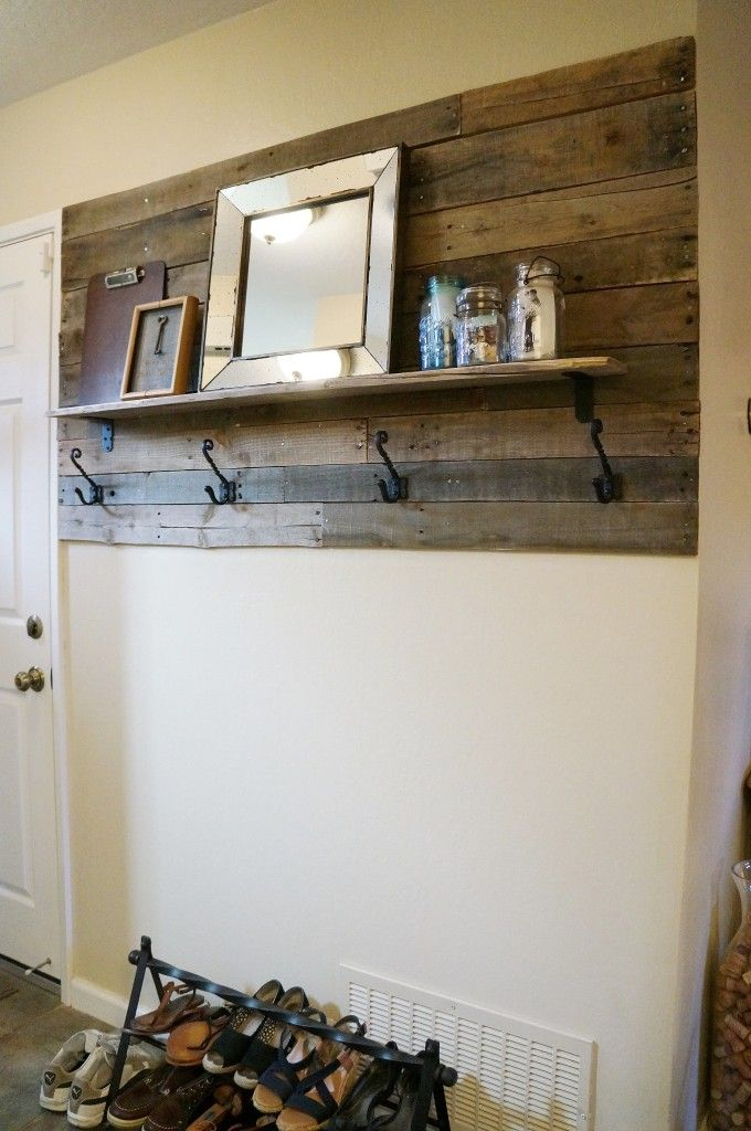 I soooo wanna do this to cheer up the front hall and hide the awful, huge fuse box cupboard! Pallet Entryway Project. bakersjar.com/entryway-project/