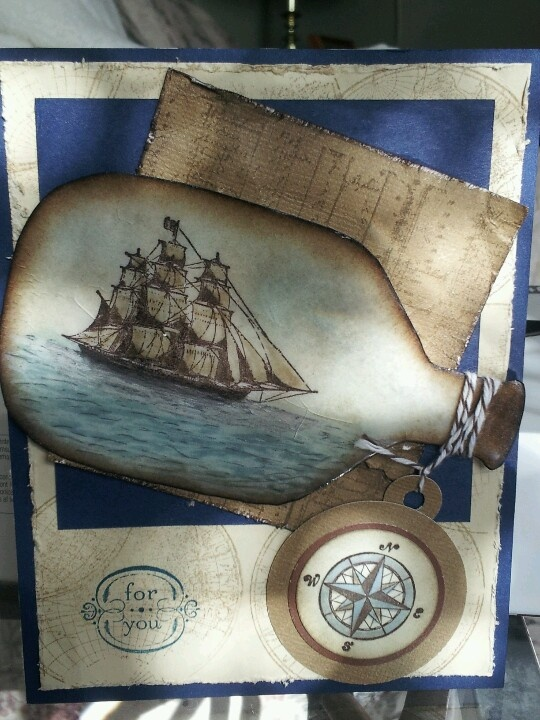 Ship in a bottle card made with Stampin' Up! The Open Sea stamp set and SU! paper and inks.  Bottle shape was a template found on the web and then covered with Clear UTEE powder and then heat embossed.  This was my CASE of Lovesrubberstamps on Splitcoaststampers: http://www.splitcoaststampers.com/gallery/photo/2143970?=21164