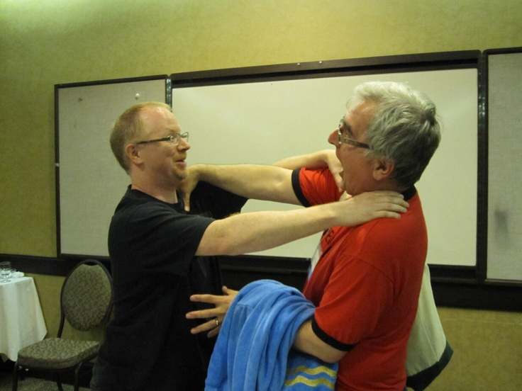 Scott Young and I having a disagreement about the possibility of extraterrestrial life, during our joint presentation at Keycon in 2010.