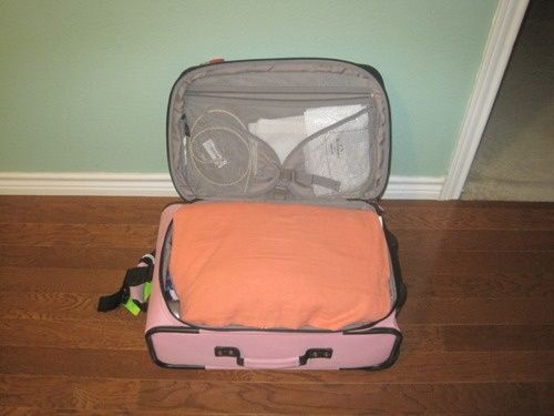 How to pack like a freaking ninja! I fit 8 days in a carry-on suitcase.