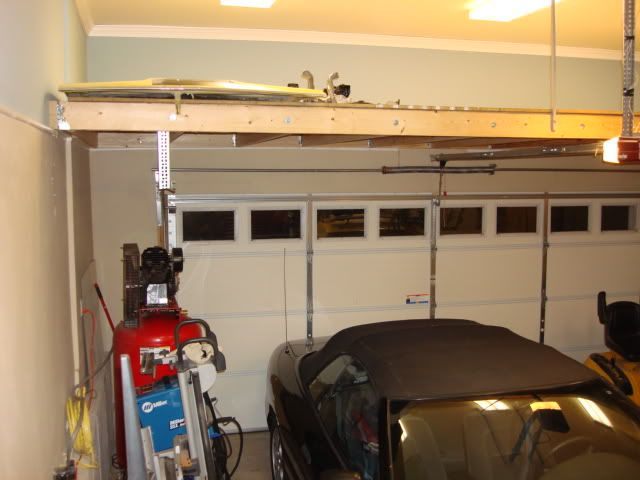 Storage loft above garage door the garage journal board for Garage mezzanine ideas