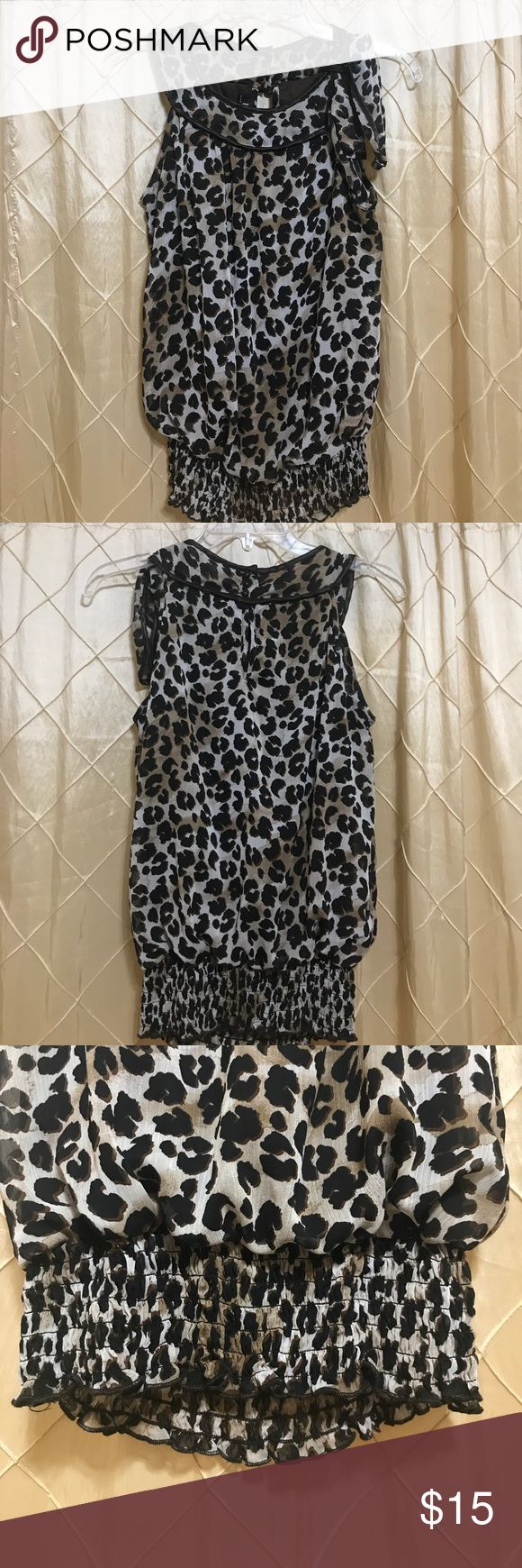 Cheetah dressy shirt A brown cheetah printed shirt. Sleeveless shirt with a bow on the left shoulder. Scrunched from the bottom. B Wear  Tops Blouses