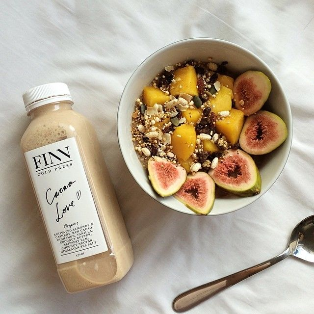 Cacao organicburst maca oatmeal with mango, puffed quinoa/brown rice, pumpkin/sunflower/chia/sesame/pomegranate/amaranth seeds, goji berries and figs + finncoldpress organic nut milk.