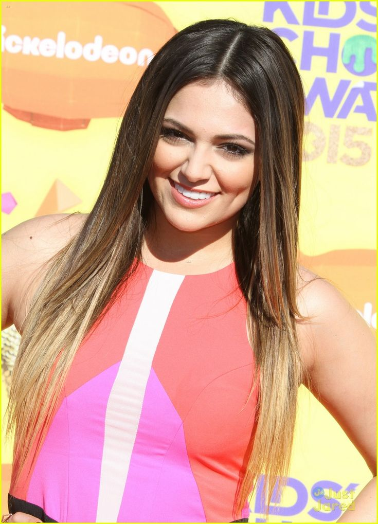 Bethany Mota brightens up the orange carpet at the 2015 Kids' Choice Awards held at The Forum in Los Angeles on Saturday afternoon (March 28).