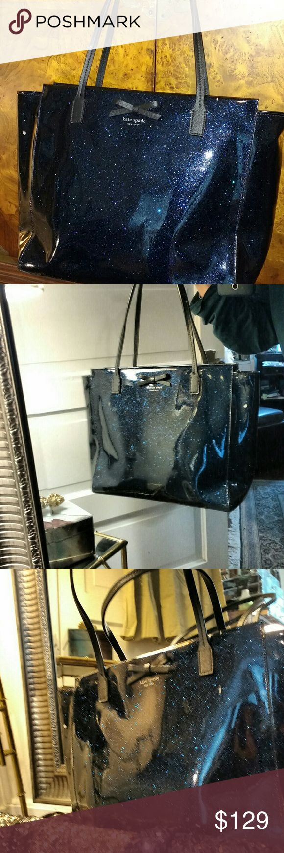 """Kate Spade  Mavis Street Taden Dark Blue Starry Gorgeous AUTHENTIC Kate Spade medium Tote with glitter leather, black leather bow and straps. A roomy tote can fit magazines, or file folders. Zipper closure,  9"""" strap drop.  The bag and lining are pristine, except there are two small scuffs on front and side- and these are clearly shown in pics above. Such a knock out bag! Kate Spade Bags Totes"""