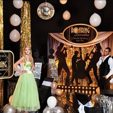 Create the perfect Roaring '20s or Gatsby scene for your #Prom. Use gold, black and silver with shining and shimmering fabrics to create a glitzy look.