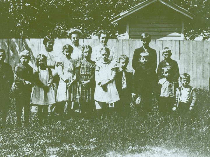Schooldays before electronics in Irondequoit: This 1897 photo shows teacher Mary Dwyer with her students