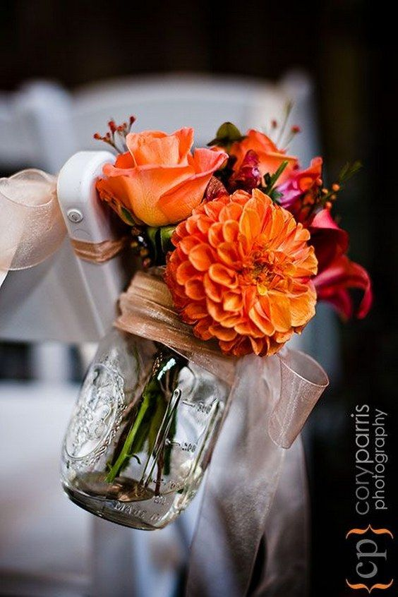 orange mason jar wedding chair decor / http://www.himisspuff.com/rustic-mason-jar-wedding-ideas/