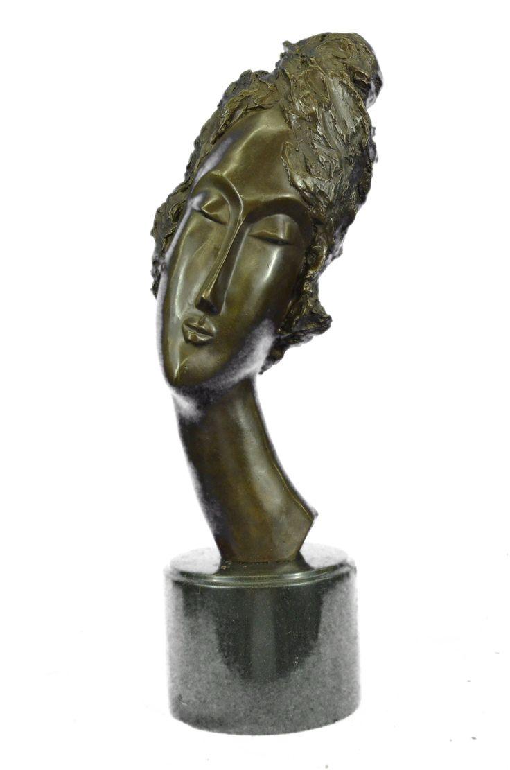 'head of a woman' bronze sculpture by amedeo modigliani (1910)