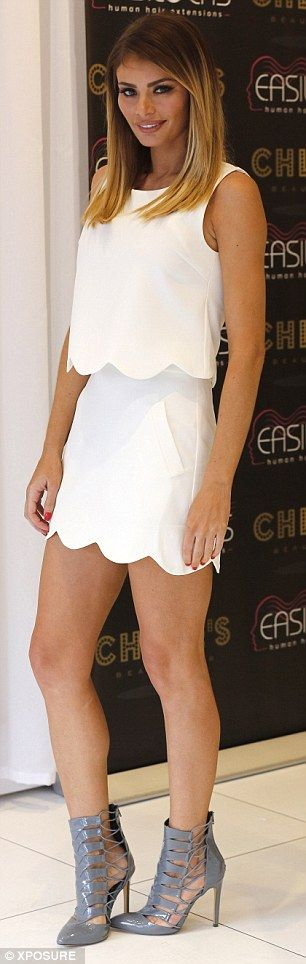 Look at that body: The 32-year-old was chic in a cream two piece and some grey caged sanda...
