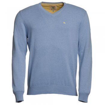 A pale blue fine cotton Magee jumper. We use melange yarns for colour and textural interest. Features include - v-neck, rib cuff and hems and a contrasting embroidered wolfhound on the chest.