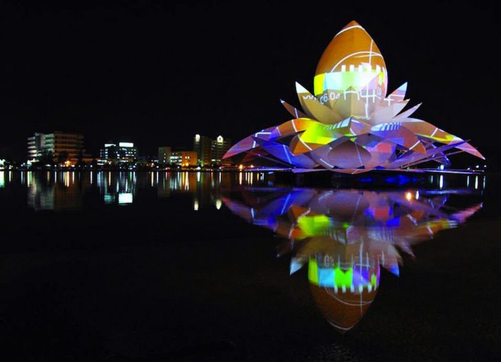 Giant floating Lotus made for a festival in Thailand. It has projectors displaying images and patterns of color.
