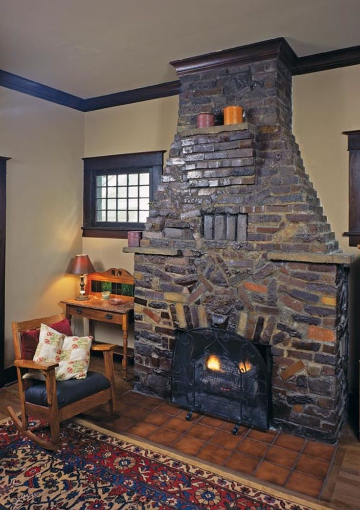 """Clinker bricks are mixed with other bricks in a style of masonry known as """"eccentric brickwork,"""" which becomes less eccentric as it moves up into the chimney. Just above the firebox, bricks form the letter A, the initial of the first owners. (Photo: Linda Svendsen)"""