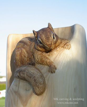 "'Chipmunk on Post' - wood carving by MK Carving and Sculpture; stair railing post carving on Western red cedar in New Hampshire; 8"" x 50"" x 8"""