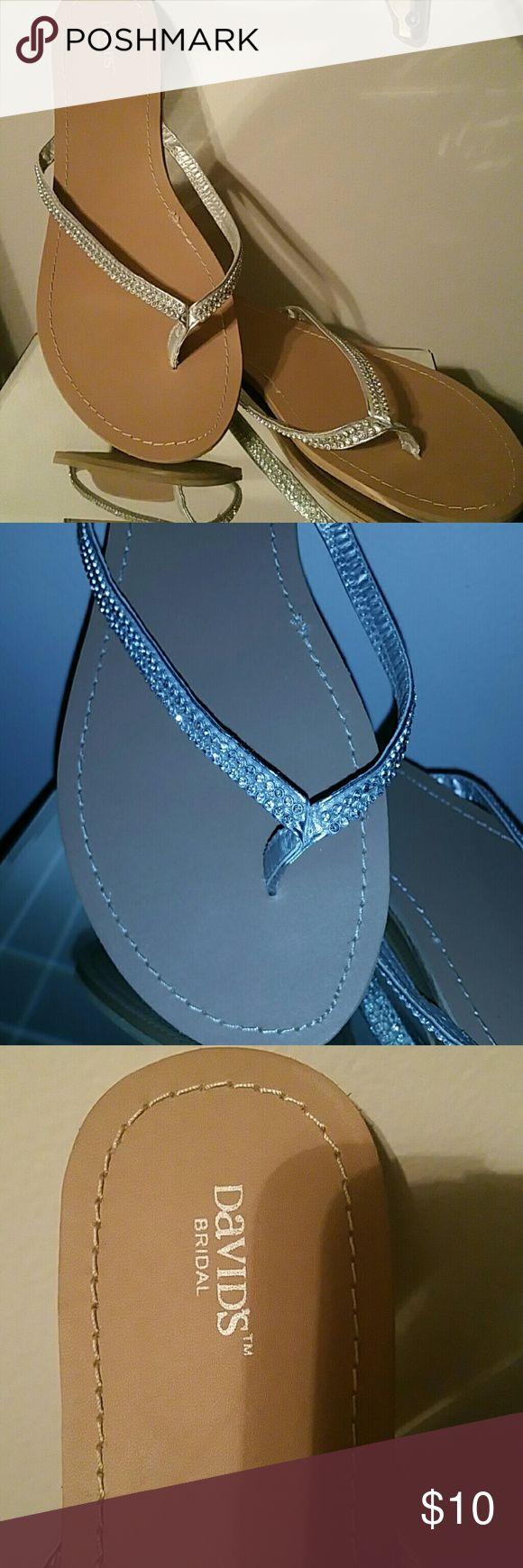 Bridal flip flops. Silver flip flops with bling. Purchased at Davids Bridal. Only worn 2 hrs. David's Bridal Shoes Sandals
