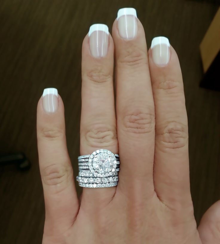 engagement ring with 3.78carat round diamond, plus diamond wedding band and band for each child ♥ #ridiculous!
