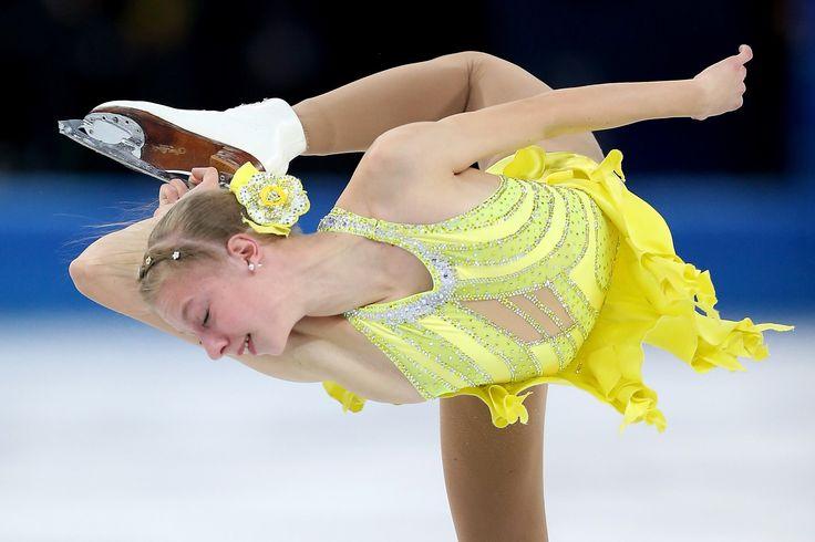 A bright rose adorned Polina Edmunds's bun. #Sochi2014