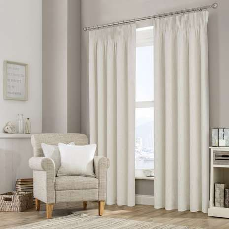 Featuring a textured finish in natural tones, these ready made curtains are fully lined with a traditional pencil pleat header....