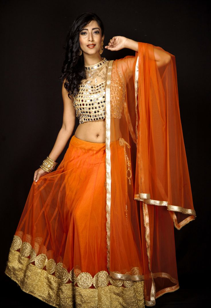 Brighten up your day & get ready to dazzle in this vibrant orange lehenga paired with mirror blouse. For bookings, Log on to www.rentanttire.com  Or Call us on 7722009477 #RentAnAttire #DifferentIsBeautiful #BookitFlauntitReturnit <3