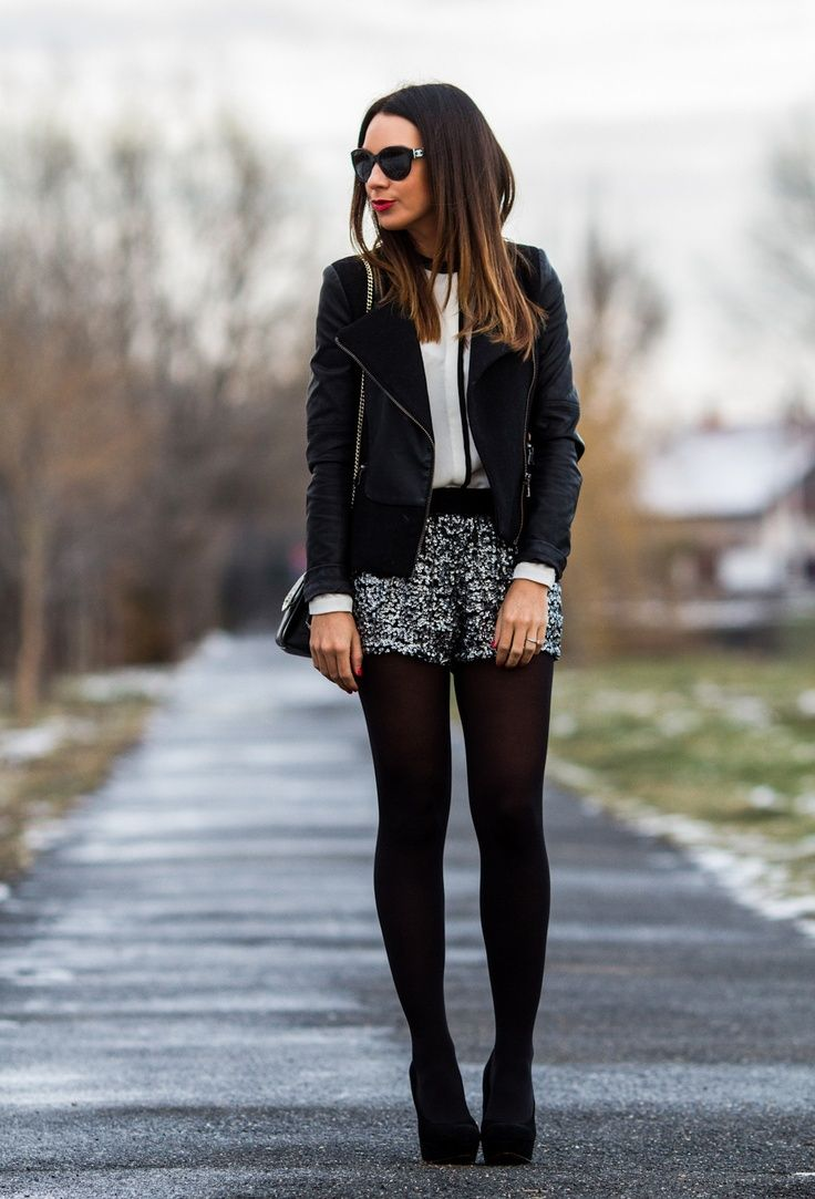 Black jacket white blosue sequin silver shorts black tights heels street fashion new years eve fashion: