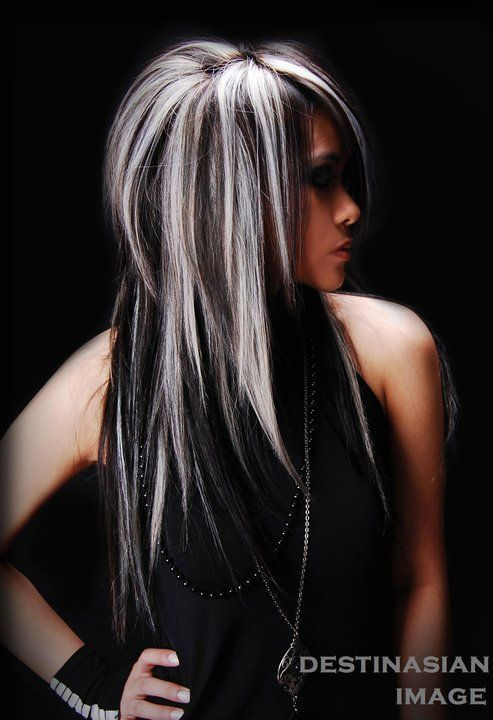 White and grey highlights. Are they real or extensions?  Only her and her hairdresser knows.