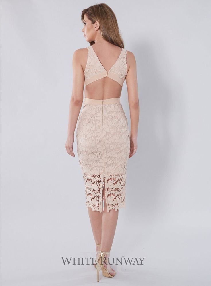 Amalia Lace Cutout Dress. A stunning dress by White Velvet. An above ankle fitted dress with cut outs at the waist and an above knee length lining.