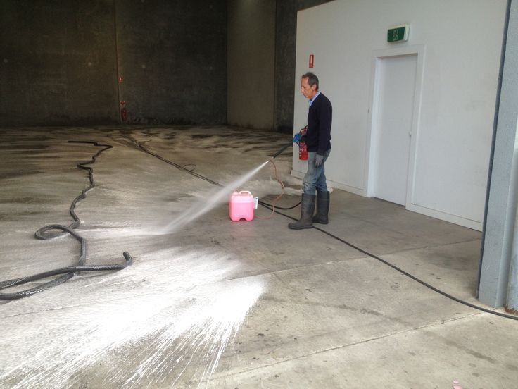 Degreasing before washing an extremely greasy floor. Next we hit it woth hot water at 5000 PSI.