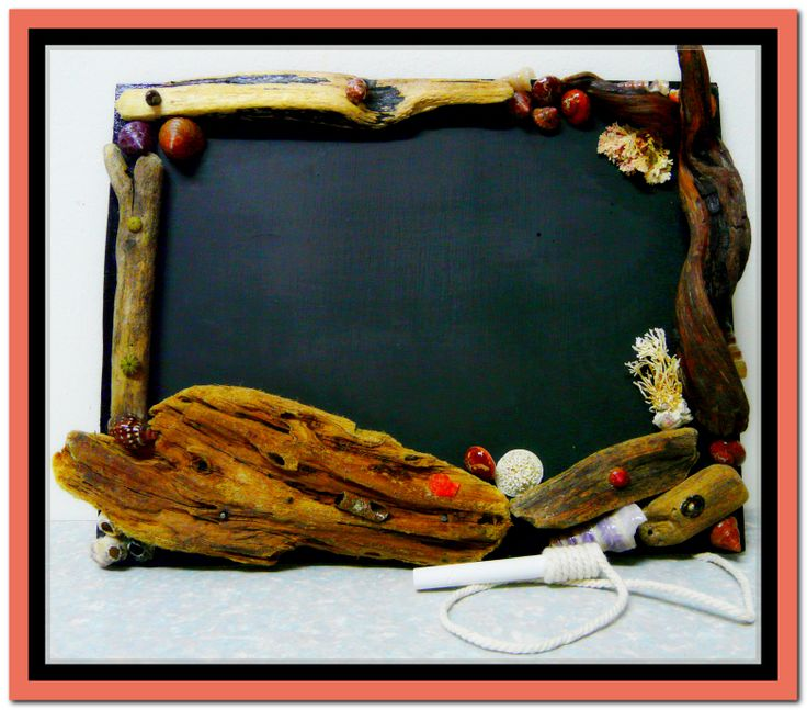 Blackboard with driftwood and shells frame
