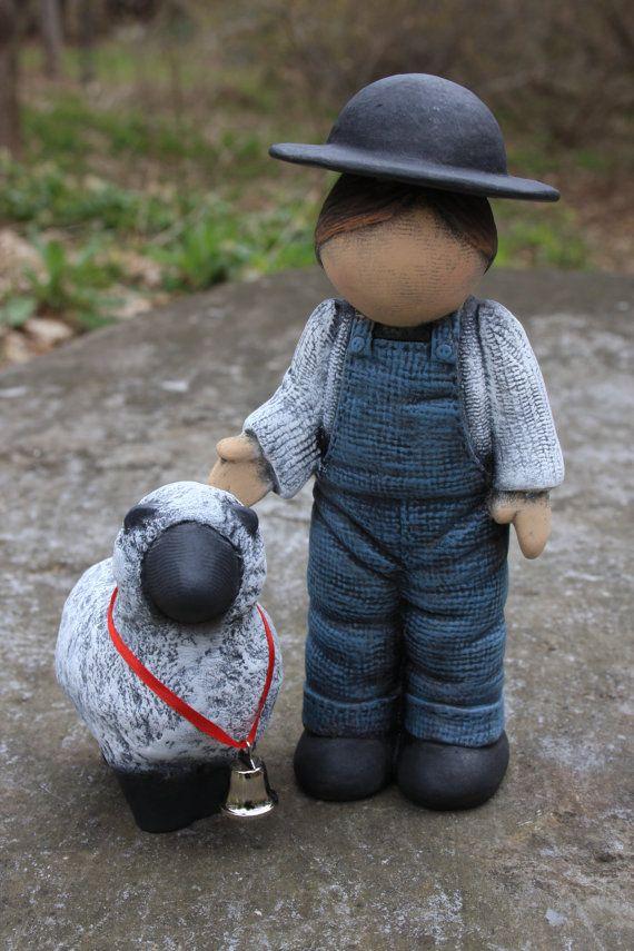 handmade Amish boy with sheep