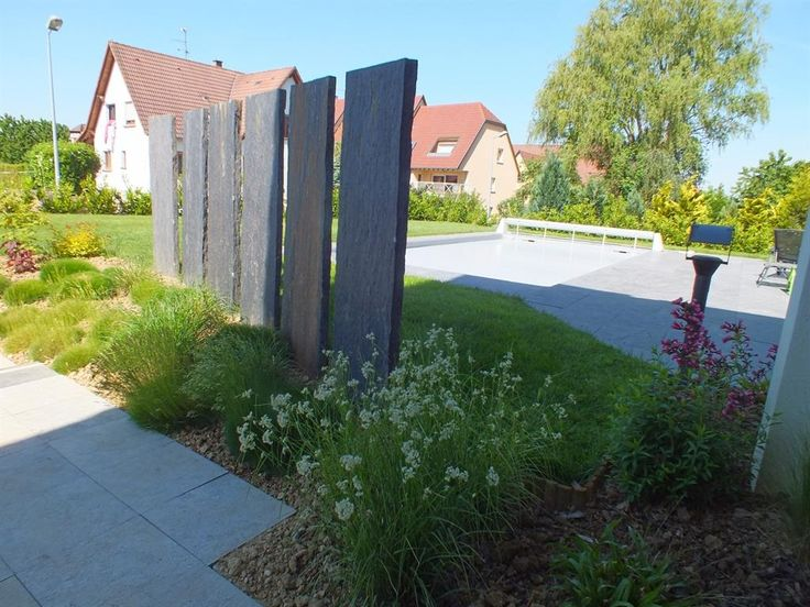 Jardins s par s par un brise vue jardin min ral - Idee brise vue jardin ...