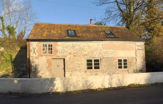 This lovingly restored and converted forge is available to rent through Dream Cottages in Weymouth