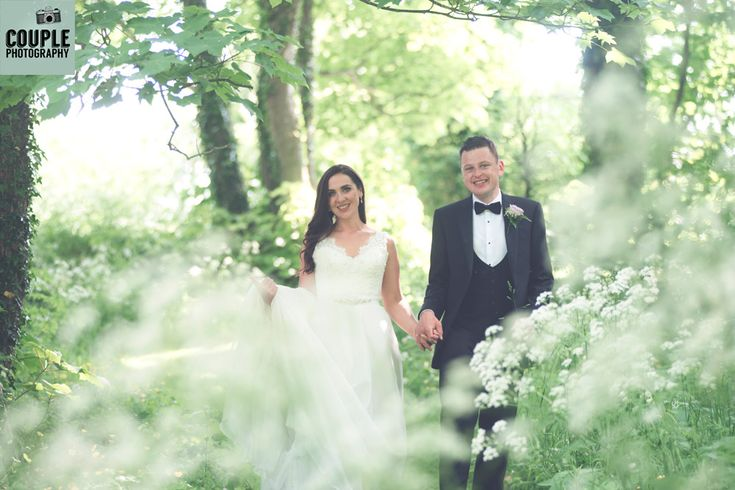 The bride & groom in this beautifully romantic setting. Completely surrounded by greenery and sunlight. Weddings at The Radisson Galway photographed by Couple Photography.