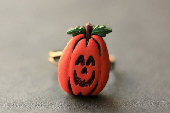Pumpkin Ring. Halloween Jewelry. JackoLantern Ring. Halloween Ring. Jack o Lantern Ring. Adjustable Ring. Bronze Ring. Handmade Jewelry. by StumblingOnSainthood from Stumbling On Sainthood. Find it now at http://ift.tt/1UI5NTR!