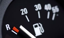 To figure out your vehicle's gas mileage, you can calculate it by first filling up the tank and resetting the trip odometer. Once you've used at least half of the gasoline in the tank, fill the tank again and note how much fuel you put in the car, as well as the mileage on the odometer. Then divide the number of miles by the gallons of fuel to get your vehicle's miles per gallon (MPG) rating. For example, if you traveled 250 miles on 10 gallons of gasoline, your car's MPG rating is 25.