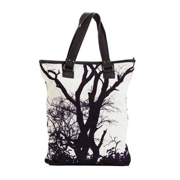 Digital Printed Tote. This striking canvas and leather tote bag features a graphic black-and-white tree image. $120.00