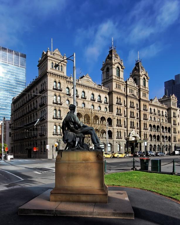 Statue of Adam Lindsay Gordon gazing at The Hotel Windsor - Melbourne, Australia