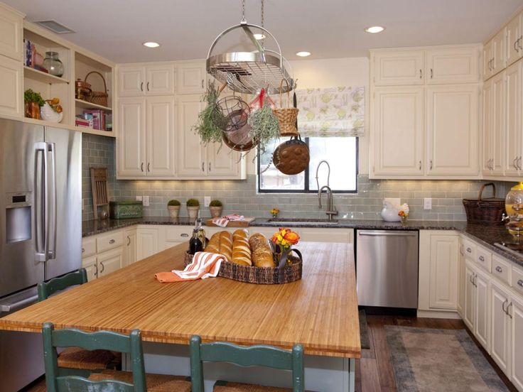 creamy cabinets, butcher block island. would do mint or green chairs with copper pots and growing herbs, very vintage eclectic homey. lighter countertops for sure.