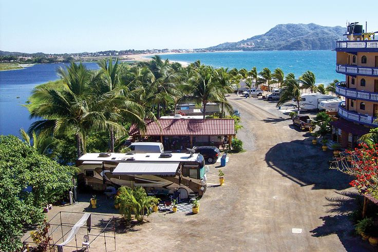 In the coastal city of Melaque, Jalisco, the Bungalows Laguna del Tule resort accommodates hotel guests and RV owners.