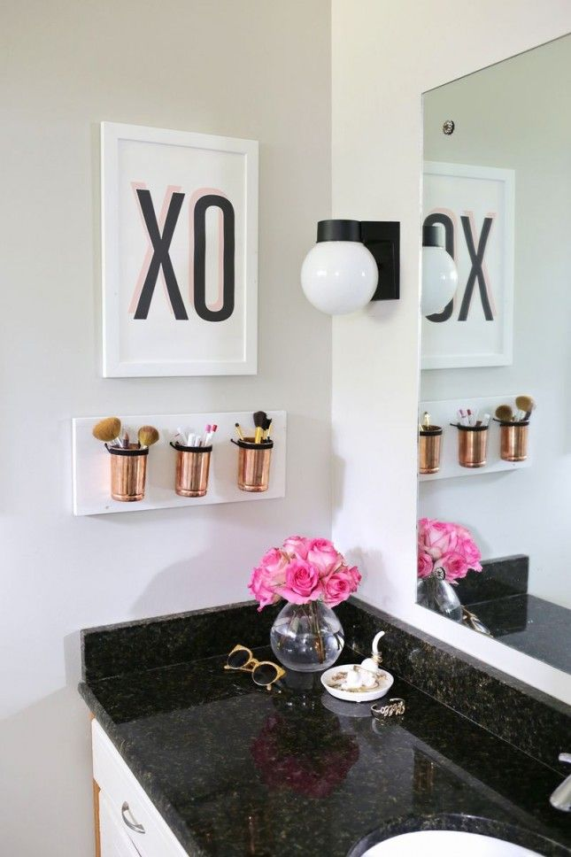 DIY these wall-mounted cup holders to hold makeup brushes + other beauty tools.