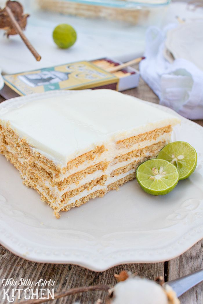 Key Lime Eclair Cake, layers of creamy filling bursting with key lime flavor between graham crackers, topped with vanilla frosting. Tastes just like a key lime pie, but much easier! from ThisSillyGirlsLife.com