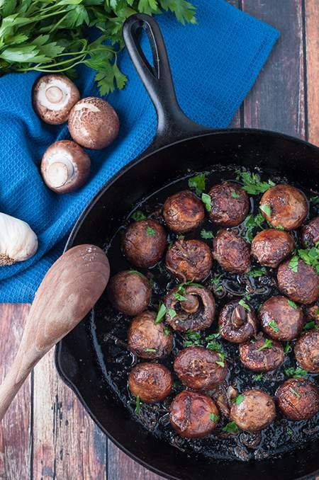 Cast iron roasted mushrooms with garlic butter is a perfect side dish!