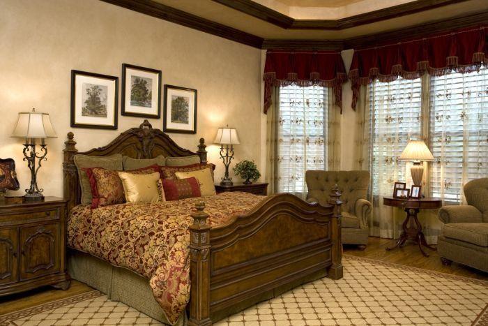 Tuscan bedroom - 3 pictures over headboard