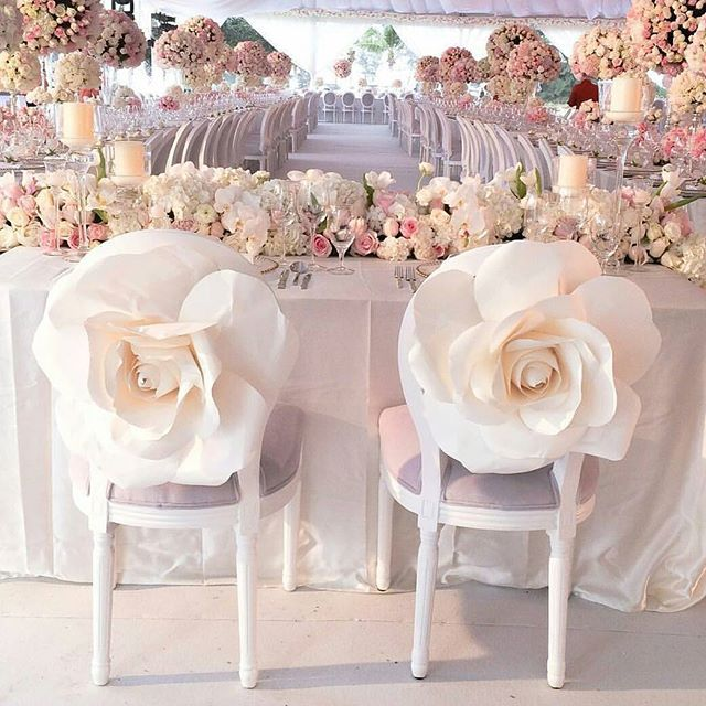 Spice up your wedding chair with this enchanting jumbo white hued flower that truly got us head over heels in love the minute we saw this inspiration by @ka_ka_man! We bet feminine brides will fall over this ethereal setup! Incorporating an abundant use of flowers and candles that truly builds a whimsical ambiance, this is the epitome of one romantic setup. Who's inspired? Tag someone who would love this and share your thoughts below!  Image via @weddingdream