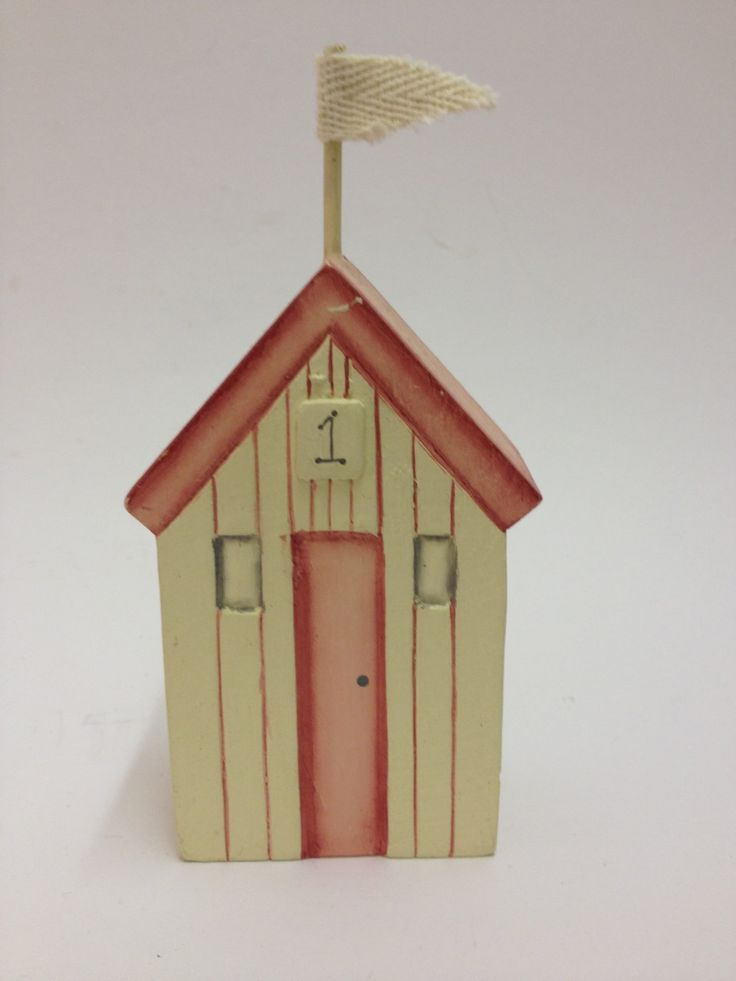 East of India Red Beach Hut £5.99 Carved wooden East of India red beach hut in Red and cream has a fabric flag and a cute addition to a nautical theme for your bathroom or home: Approx Dimensions: H: 13cm x W: 6.5cm x D: 3.7cm