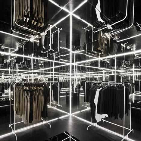 Zuo Corp by Super Super and Inside/Outside    Mirrors lining the ceilings and walls of a tiny pop-up clothing shop in Warsaw create the illusion of endless rails of garments