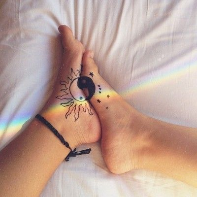 50 Charming Foot Tattoo Designs...Love this tattoo, it's the white ying-yang as the sun and the black ying-yang as the moon with stars around and when it comes together it makes s ying-yang