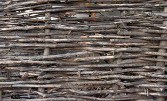 Woven willow fencing, also known as wattle fencing, adds a rustic touch to any garden.